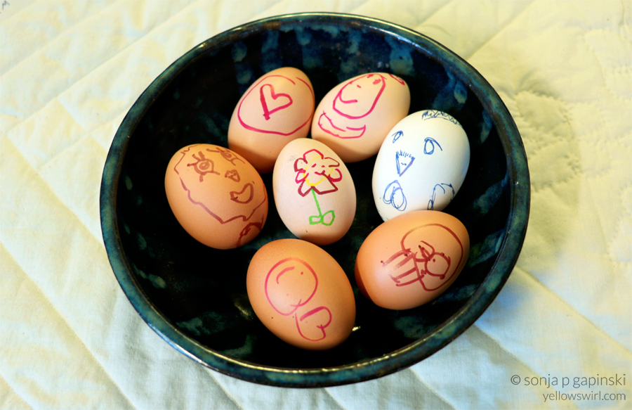 kids decorating eggs